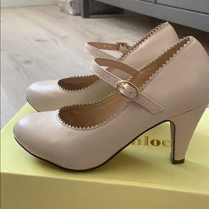 Cream ModCloth high heeled shoes